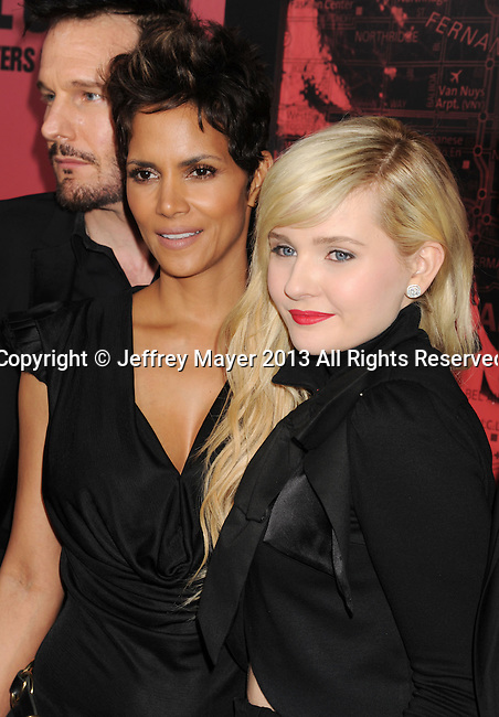 HOLLYWOOD, CA - MARCH 05: Halle Berry and Abigail Breslin arrive at the 'The Call' - Los Angeles Premiere at ArcLight Hollywood on March 5, 2013 in Hollywood, California.