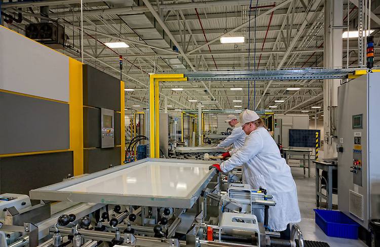 Solar Power Industries - Belle Veron, Pa - The final assembly process of the solar panel is heavily automated with the significant use of specialized robotics.