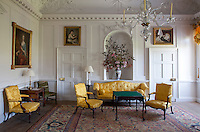 Antique furniture in the family parlour has been newly upholsterd in yellow silk damask