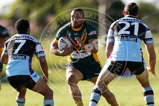 Kene Te Whata of the Wyong Roos prepares to be tackled by Penani Manumalealii and Jonathan Blair of the Cronulla Sharks during Round 5 of the 2013 NSW Cup at Morrie Breen Oval on April 7, 2013 in Wyong, Australia. (Photo by Paul Barkley/LookPro)
