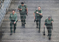Armed prison guards walk through a courtyard at the Lai Chi Kok Reception Centre shortly before British ex-banker Rurik Jutting boarded a high security prison van to bring him to his trial at the High Court of Hong Kong for the alleged killing of two Indonesian women in October 2014, Hong Kong, China, 01 November 2016.