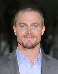 Stephen Amell at The HBO Premiere of the 4th Season of True Blood held at The Arclight Cinerama Dome in Hollywood, California on June 21,2011                                                                               © 2010 Hollywood Press Agency
