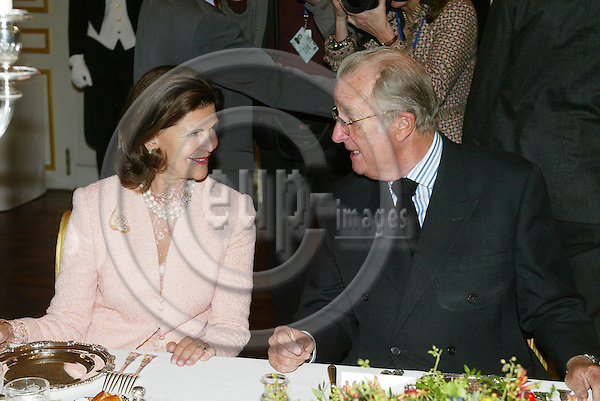 "BRUSSELS - BELGIUM - 17 NOVEMBER 2005 -- Swedish Queen Silvia and Belgium King Albert II during the lunch at the Royal Palace in Brussels before the opening of the exhibition about ""Queen Astrids life in Belgium"".  PHOTO: ERIK LUNTANG / EUP-IMAGES.."