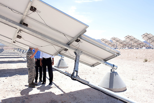 Las Vegas, NV - May 27, 2009 -- United States President Barack Obama views solar panels during a tour of the Photovoltaic Array at Nellis Air Force Base in Las Vegas with U.S. Senator Harry Reid (Democrat of Nevada) and Colonel Howard Belote, base commander, May 27, 2009. .Mandatory Credit: Pete Souza - White House via CNP