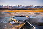 Sunrise at the Hilltop Hotsprings with the High Sierra mountains in the Owens Valley just south of Mammoth Lakes along California's scenic desert highway 395.
