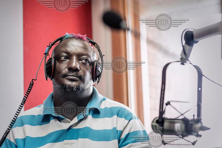 Author and gay rights activist Binyavanga Wainaina during an interview at a radio station.