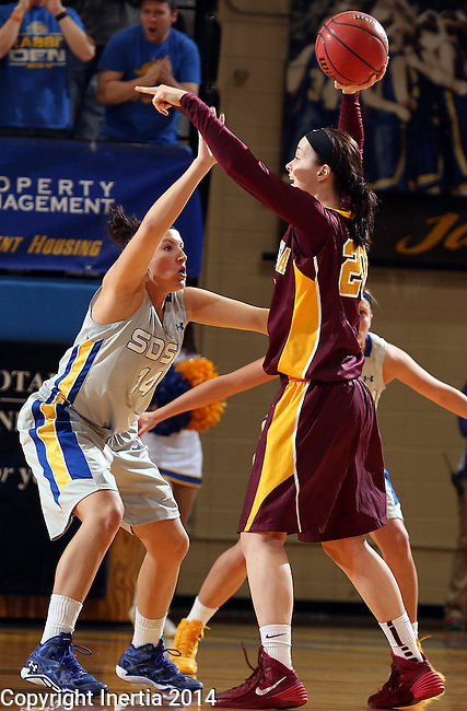 BROOKINGS, SD - MARCH 27:  Hannah Strop #14 from South Dakota State University applies pressure to Kayla Hirt #20 from the University of Minnesota in the first half of their sweet sixteen gameThursday night at Frost Arena in Brookings. (Photo by Dave Eggen/Inertia)