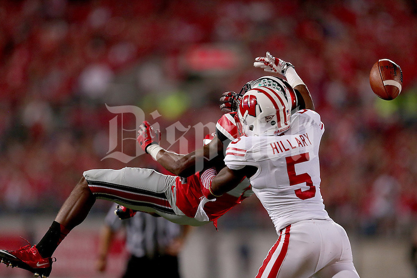 Wisconsin Badgers cornerback Darius Hillary (5) breaks up a pass intended for Ohio State Buckeyes wide receiver Philly Brown (10) during the first half of the game between Ohio State and Wisconsin at Ohio Stadium on Saturday, September 28, 2013. (Columbus Dispatch photo by Jonathan Quilter)