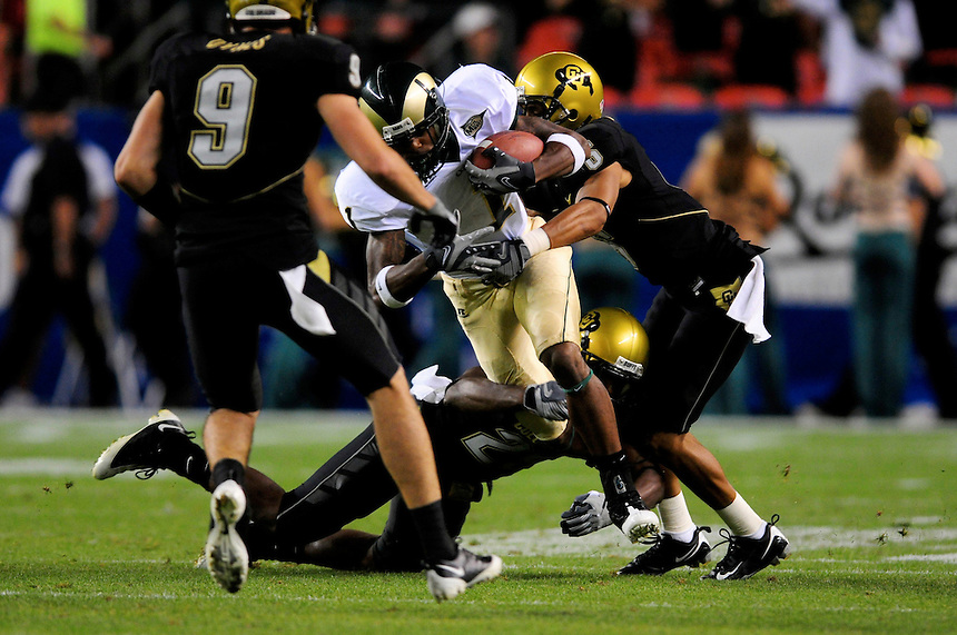 31 Aug 2008: Colorado State wide receiver Ryan Gardner is surrounded by Colorado defenders trying to advance the ball. The Colorado Buffaloes defeated the Colorado State Rams 38-17 at Invesco Field at Mile High in Denver, Colorado. FOR EDITORIAL USE ONLY