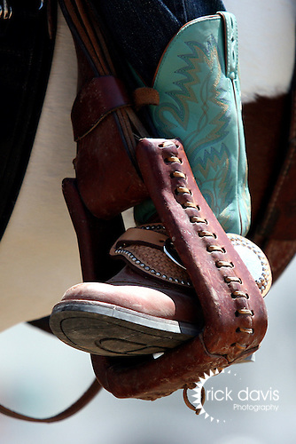 A fancy pair of cowboy boots and spur strap.