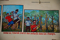 A hand-painted sign warns against the use of child labour in cocoa plantations.