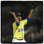 Closer Ezequiel Zabaleta (4) of the Columbia Fireflies shouts and raises his arms after the final out to earn the save in a 3-2 win over the Charleston RiverDogs on Saturday, April 6, 2019, at Segra Park in Columbia, South Carolina. Charleston won, 6-1. (Tom Priddy/Four Seam Images)