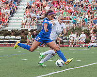 In a National Women's Soccer League Elite (NWSL) match, Portland Thorns FC defeated the Boston Breakers, 2-1, at Dilboy Stadium on July 21, 2013.  Boston Breakers forward Sydney Leroux (2) attacks the goal as Portland Thorns FC defender Kathryn Williamson (5) prepares to tackle.