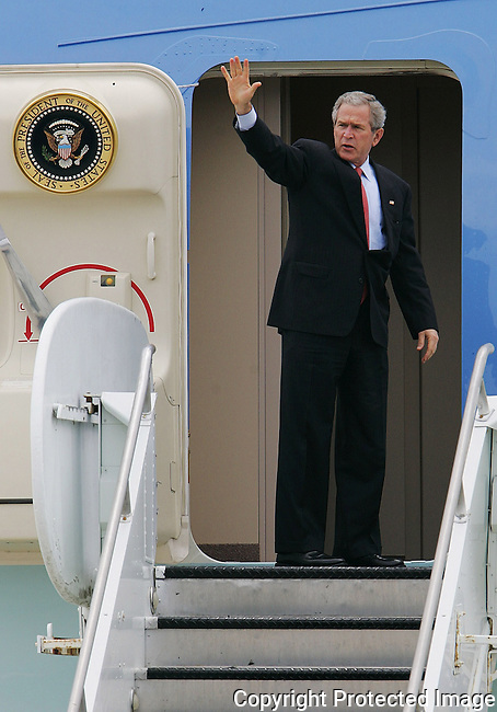 President George W. Bush waves as he boards Air Force One at Orlando International Airport, in Orlando, Fla., Wednesday, May 10, 2006.  Bush was in Orlando for a town hall meeting to discuss Medicare.(Brian Myrick)