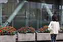 A pedestrian stands in front of the LOTTE Japan headquarters in Shinjuku on July 29, 2015, Tokyo, Japan. Shares in Lotte group companies jumped up on Wednesday as investors expect founding family members to try to increase their holdings. On Tuesday the board of Lotte Holdings had sacked 92-year-old founder Shin Kyuk-ho from his position as co-CEO. This led to speculation that other family members would try to compete for control of the Korean conglomerate. (Photo by Rodrigo Reyes Marin/AFLO)