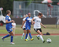 Portland Thorns FC midfielder Meleana Shim (6) passes the ball as Boston Breakers midfielder Joanna Lohman (11) closes. In a National Women's Soccer League (NWSL) match, Portland Thorns FC (white) defeated Boston Breakers (blue), 2-1, at Dilboy Stadium on July 21, 2013.