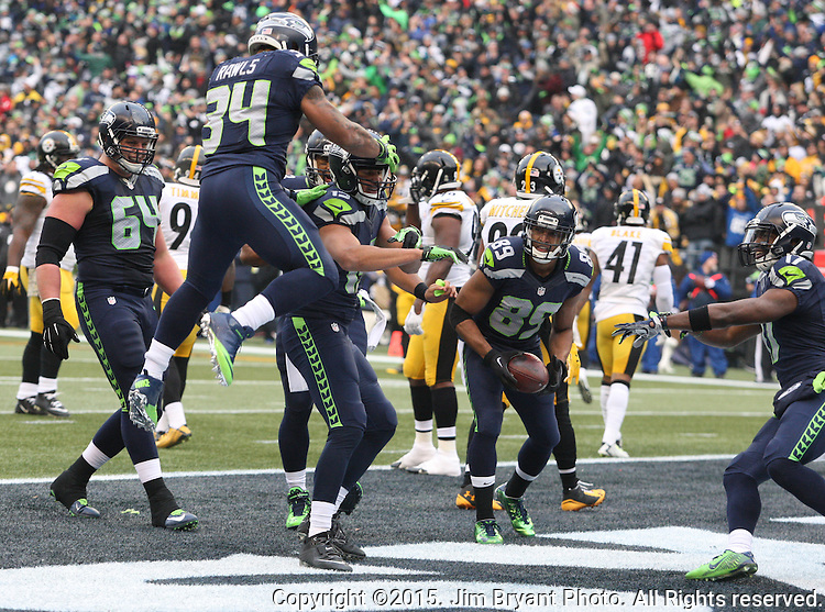 Seattle Seahawks running back Thomas Rawls celebrates with wide receiver Jermaine Kearse (15) after Kearse scored a second quarter touchdown against the Pittsburgh Steelers at CenturyLink Field in Seattle, Washington on November 29, 2015.  The Seahawks beat the Steelers 39-30.      ©2015. Jim Bryant Photo. All Rights Reserved.