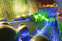 """Festival International des Jardins de Chaumont-sur-Loire, thème de lannée 2010, Jardins corps et âmes : jardin """"Le creux de la main"""" par l'association SemisPublics et Juliette Berny, vue de nuit. (Mention obligatoire  Festival des Jardin de Chaumont-sur-Loire et des créateurs des jardins et pas d'usage publicitaire sans autorisation préalable) // spheres and slate floor by night in the Festival International des Jardins de Chaumont-sur-Loire, theme of the year 2010, """"Jardins corps et âmes"""" : garden """"Le creux de la main"""" par l'association SemisPublics et Juliette Berny (the artistes Must Be Credited and the Festival International des Jardins de Chaumont-sur-Loire)"""
