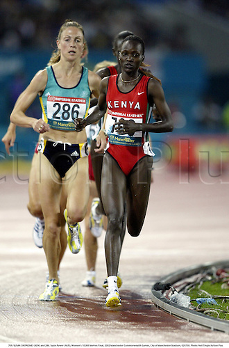 709. SUSAN CHEPKEMEI (KEN) and 286. Susie Power (AUS), Women's 10,000 Metres Final, 2002 Manchester Commonwealth Games, City of Manchester Stadium, 020730. Photo: Neil Tingle/Action Plus...athletics athletes athlete.runner runners run running.track event distance.woman......................................