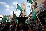 Palestinian Hamas supporters shout slogans against Israel during a protest to support Hamas and against the Israeli attack to Gaza strip in the West Bank city of Nablus, 04 August 2014. Israel will not end its offensive in Gaza until rocket attacks against it end, Prime Minister Benjamin Netanyahu says, dampening speculation that the military effort could be wrapped up imminently. A seven-hour humanitarian ceasefire called by Israel went into effect in most of the Gaza Strip on 04 August after an attack that killed 10 people at a UN-run school. The temporary ceasefire was to last from 10 am (0700 GMT) until 5 pm in the entire enclave except for the area east of the town of Rafah in southern Gaza - a focal point of fighting since a botched attempt by Palestinian militants to snatch a soldier there on 01 August. . Photo by Nedal Eshtayah