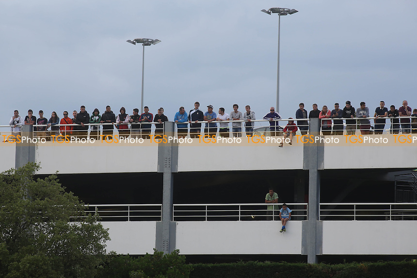 Some local football fans stood on the top floor of a nearby car park to watch the match - England Under-20 vs Brazil Under-20 - Toulon Tournament Group B Football at Stad L Hon, Saint Raphael, France - 26/05/14 - MANDATORY CREDIT: Paul Dennis/TGSPHOTO - Self billing applies where appropriate - contact@tgsphoto.co.uk - NO UNPAID USE