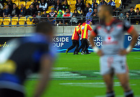 A pitch invader is escorted from the field during the NRL Premiership round seven match between the NZ Warriors and Canterbury Bulldogs at Westpac Stadium, Wellington, New Zealand on Saturday, 16 April 2016. Photo: Dave Lintott / lintottphoto.co.nz