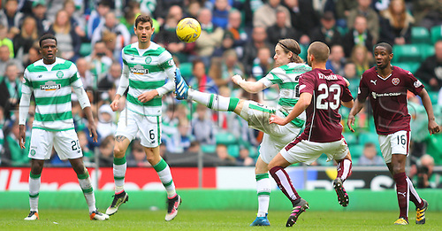 02.04.2016. Celtic Park, Glasgow, Scotland. Scottish Football Premiership Celtic versus Hearts. Stefan Johansen clears from Perry Kitchen