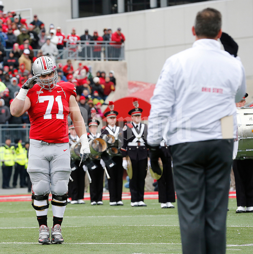 Ohio State Buckeyes offensive linesman Corey Linsley (71)gets and gives a salute from Urban Meyer before the start of the game against Indiana at Ohio Stadium in Columbus, Ohio on November 23, 2013.  (Chris Russell/Dispatch Photo)