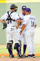 Winston-Salem Dash pitching coach J. R. Perdew (31) has a chat on the mound with pitcher Bryan Blough (9) and catcher Kevan Smith (24) during the Carolina League game against the Potomac Nationals at BB&T Ballpark on July 8, 2013 in Winston-Salem, North Carolina.  The Dash defeated the Nationals 12-9.  (Brian Westerholt/Four Seam Images)