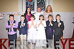 Pupils of Scoil Mhichi?l, Baile an Sceilg who made their First Holy Communion on Saturday, pictured here in St Michaels Church, Dungeagan, front l-r; Emmet O? Se?, Mark O? Connroi?, Emma Ni? Dhuillea?in, Cla?r Ni? Chonchu?ir, Eamon O? hArta, Senan O? Conaill, back l-r; Olivia Ni? Ghoga?in, Fr Gunn & Sheila Ni? Chonaill.
