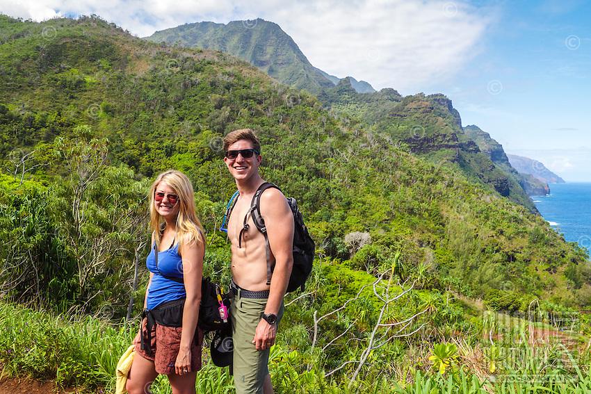A couple hiking the Kalalau Trail on Kaua'i.