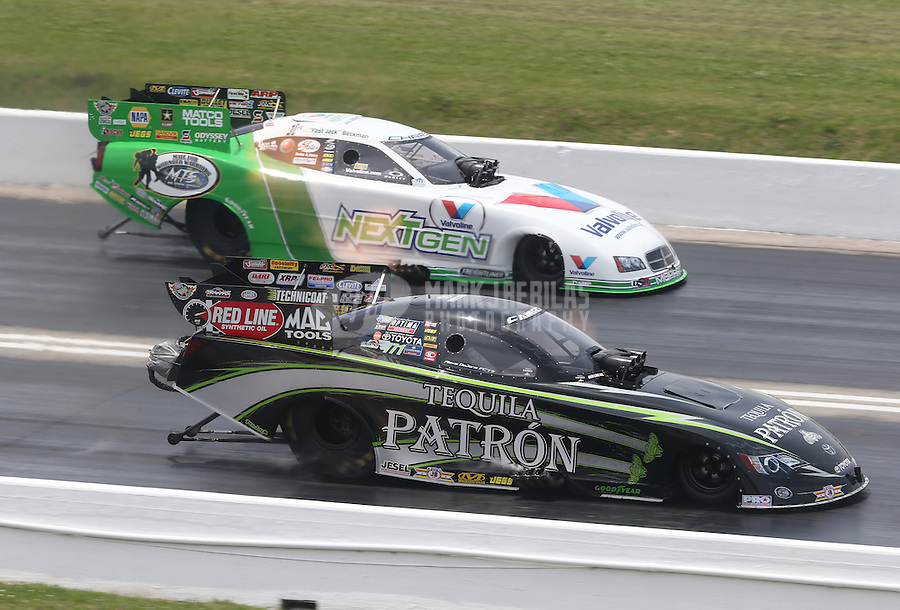 Apr. 28, 2013; Baytown, TX, USA: NHRA funny car driver Alexis DeJoria (near lane) races alongside Jack Beckman during the Spring Nationals at Royal Purple Raceway. Mandatory Credit: Mark J. Rebilas-