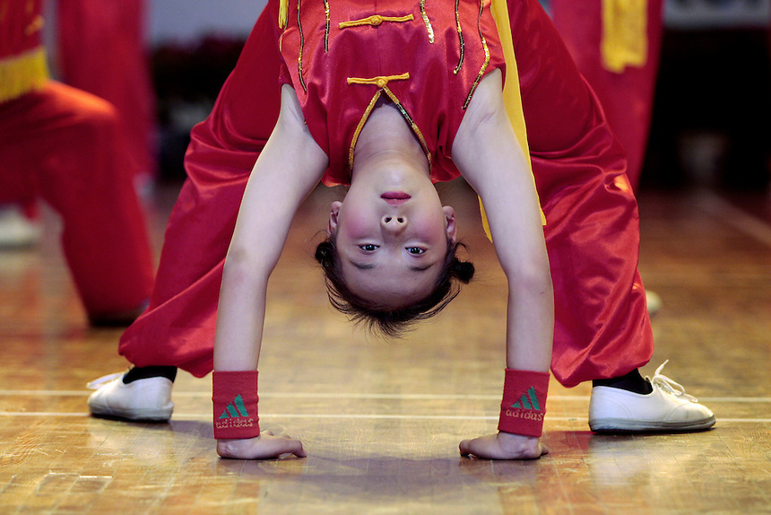 A dancer takes part in a community event to herald the   upcoming Olympics, in Jinchuan, Gansu, in western China.