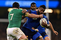 Mathieu Bastareaud of France is tackled by Sean O'Brien of Ireland. Rugby World Cup Pool D match between France and Ireland on October 11, 2015 at the Millennium Stadium in Cardiff, Wales. Photo by: Patrick Khachfe / Onside Images