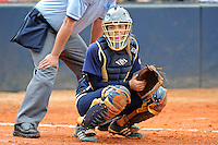 11 February 2012:  FIU's Megan Horne (00) catches as the University of Louisville Cardinals defeated the FIU Golden Panthers, 4-2, as part of the COMBAT Classic at the FIU Softball Complex in Miami, Florida.