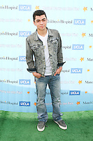 SANTA MONICA, CA - OCTOBER 21:  Adam Irigoyen at the Mattel Party On The Pier Benefiting Mattel Children's Hospital UCLA - Red Carpet at Pacific Park at Santa Monica Pier on October 21, 2012 in Santa Monica, California. © mpi20/MediaPunch Inc. /NortePhoto