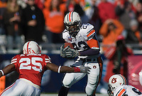 01 January 2007: Auburn running back Kenny Irons (#23) dodges Nebraska defender Andre Jones (#25) during the 2007 AT&T Cotton Bowl Classic between The University of Auburn and The University of Nebraska at The Cotton Bowl in Dallas, TX.
