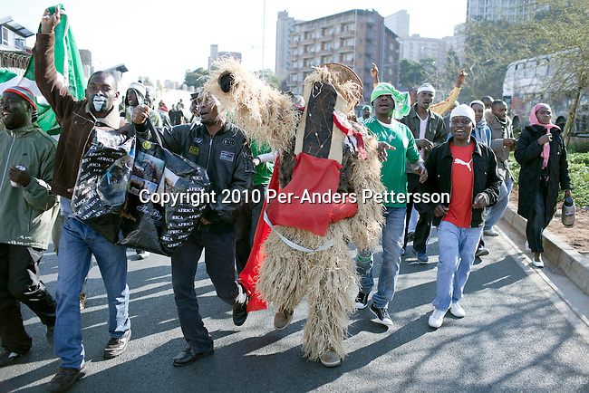 JOHANNESBURG, SOUTH AFRICA - JUNE 12: Nigerian soccer fans march to a game between Nigeria and Argentina on June 12, 2010 outside Ellis Park stadium in Johannesburg, South Africa. Many Nigerian people reside in South Africa. Nigeria lost the game and didn't advance past the group stage in the 2010 World Cup, held in South Africa. In hosting the largest sporting event in the world, South Africa has a chance to impress the world with their country, hoping that the month long event will bring long lasting benefits for the country. (Photo by Per-Anders Pettersson)