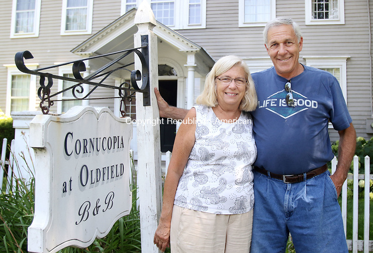 SOUTHBURY CT. 27 July 2017-073117SV05-Ed Edelson and his wife Christine Edelson stand outside Cornucopia at Oldfield Bed and Breakfast in Southbury Monday.<br /> Steven Valenti Republican-American