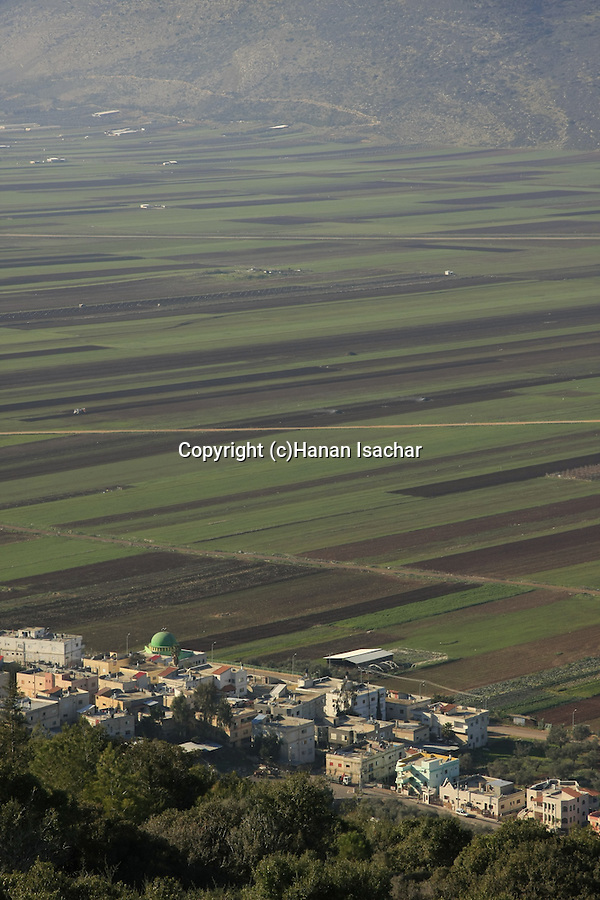 Israel, Lower Galilee. Arab village Uzeir in Beit Netofa valley as seen from Turan scenic road
