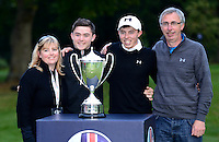 Matthew Fitzpatrick of England poses with Brother Alex, Father Rusell and Mother Susan following his victory during Round 4 of the 2015 British Masters at the Marquess Course, Woburn, in Bedfordshire, England on 11/10/15.<br /> Picture: Richard Martin-Roberts | Golffile