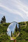 Round convex safety mirror showing Columbia River Gorge landscape, Cascade Locks, Oregon