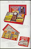 BNPS.co.uk (01202 558833)<br /> Pic: Nestle/BNPS<br /> <br /> ***Please use full byline***<br /> <br /> Early selection boxes included luxury items like clocks as well as chocolate. <br /> <br /> A fascinating archive of vintage selection boxes have emerged to reveal how the common stocking filler was once a luxurious present that families would save all year for.<br /> <br /> The assorted chocolate packs were launched by Rowntrees in the 1920s after the success of their Christmas hampers.<br /> <br /> They were considered as extremely extravagant gifts with an early box from 1927 costing 10 shillings, the equivalent of one weeks rent for a poor, working class family.<br /> <br /> The boxes contained some of the first chocolate bars invented by the company that are no longer in existance, including Nut Cracknel, Cream Tablette, and Motoring bars.<br /> <br /> Families began putting aside money throughout the year to afford the must-have gifts, which became more extravagant as their popularity grew.<br /> <br /> Rowntrees provided newsagents and grocery shops with special Christmas Club Cards which buyers used to pay weekly installments towards the selection boxes.<br /> <br /> In the 1930s Rowntrees began adding novelty items to the packs such as vases, carriage clocks, and cutlery sets, which acted as keepsakes once the chocolate had been eaten.<br /> <br /> They ranged in price from 2 shillings and six pence up to 10 shillings depending on the size of the enclosed gift.