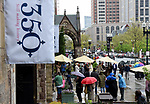 BOSTON, MAY 12:   Rain didn't dampen the spirit of the attendees as they wait for cupcakes and ice cream out the side the church during a service to celebrate the 350th anniversary, Sunday, May 12, 2019, at the old South Church in Boston. Jim Michaud / MediaNews Group/Boston Herald)