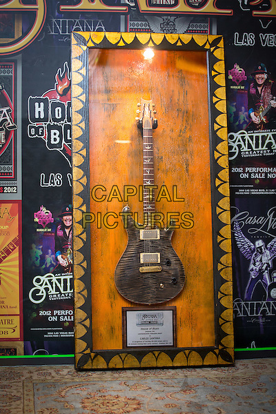 LAS VEGAS, NV - November 3: ***HOUSE COVERAGE*** <br /> Carlos Santana display pictured as House of Blues executives honor Santana with the a commemorative display marking the sale of his 100,000th ticket to An Intimate Evening with Santana: Greatest Hits Live at House of Blues Las Vegas at Mandalay Bay Resort in Las Vegas, NV on November 3, 2015. <br /> CAP/MPI/EKP<br /> &copy;EKP/MPI/Capital Pictures
