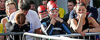 05 AUG 2006 - HOLME PIERREPONT, GBR - Competitors listen to the race briefing before the start of the British Club Relay Triathlon Championships at the National Watersports Centre (PHOTO (C) NIGEL FARROW)