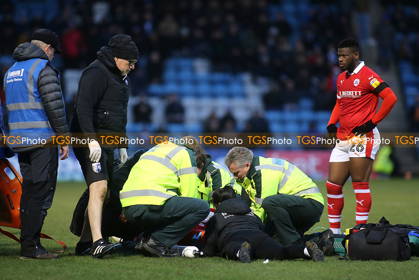 The medical teams from both sides surround Barnsley's Kieffer Moore after he suffered a nasty injury from a clash of heads during Gillingham vs Barnsley, Sky Bet EFL League 1 Football at The Medway Priestfield Stadium on 9th February 2019