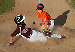 Garrett Winner of Nippenose Valley beats the tag as Jersey Shore GSV pitcher Bryce Wandell  defends the plate in the Little League Baseball district playoffs.