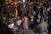 """Mehr als 3.500 Menschen protestierten am Samstag den 22. November 2014 in Berlin Marzahn-Hellersdorf gegen einen Aufmarsch von ca. 550 Neonazis, Hooligans, NPD-Mitgliedern, Mitgliedern der Neonazipartei """"Die Rechte"""", sowie einer sog. Buergerinitiative """"Gegen Asylmissbrauch den Mund aufmachen"""".<br /> Die Rechtsradikalen wollten gegen eine geplante Fluechtlingsunterkunft protestieren und durch den Stadtteil marschieren.<br /> Dagegen versammelten sich bereits Stunden vor dem Neonazi-Aufmarsch ueber 1.500 Menschen an mehreren Punkten der Marschroute an den Polizeiabsperrungen.<br /> Bis zum Einbruch der Dunkelheit konnte der rechtsradikale Aufmarsch nur ca. 70 Meter Wegstrecke zurueck legen und wurde dann von der Polizei in einer chaotischen Aktion zum S-Bahnhof gebracht. Gegendemonstranten gelang es nach unverstaendlichen Polizeimanoevern bis auf wenige Meter an die Rechtsradikalen zu gelangen und es kam zu Auseinandersetzungen bei denen beide Seiten sich mit Flaschen, Steinen und Feuerwerkskoerpern bewarfen.<br /> Im Bild: Gegendemonstranten versuchen den Weg der Rechtsradikalen zum S-Bahnhof zu blockieren, werden jedoch von Spezialkraeften der Bundepolizei von der Strasse geschafft.<br /> 22.11.2014, Berlin<br /> Copyright: Christian-Ditsch.de<br /> [Inhaltsveraendernde Manipulation des Fotos nur nach ausdruecklicher Genehmigung des Fotografen. Vereinbarungen ueber Abtretung von Persoenlichkeitsrechten/Model Release der abgebildeten Person/Personen liegen nicht vor. NO MODEL RELEASE! Nur fuer Redaktionelle Zwecke. Don't publish without copyright Christian-Ditsch.de, Veroeffentlichung nur mit Fotografennennung, sowie gegen Honorar, MwSt. und Beleg. Konto: I N G - D i B a, IBAN DE58500105175400192269, BIC INGDDEFFXXX, Kontakt: post@christian-ditsch.de<br /> Bei der Bearbeitung der Dateiinformationen darf die Urheberkennzeichnung in den EXIF- und  IPTC-Daten nicht entfernt werden, diese sind in digitalen Medien nach §95c UrhG rechtlich geschuetzt. Der Urhebervermerk wi"""