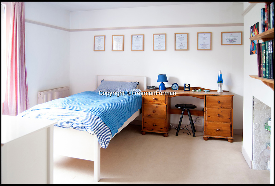 BNPS.co.uk (01202 558833)<br /> Pic: FreemanForman/BNPS<br />  <br /> Now pay attention 007 fans...<br /> <br /> This charming Georgian property is a far cry from anything you would expect to have a link with James Bond - but it was the home of everyone's favourite gadget man Q.<br /> <br /> Actor Desmond Llewelyn made the character a household name and outlasted a string of leading actors, starring in 17 films in the spy series over 36 years.<br /> <br /> But away from his fame among generations of Bond fans, he lived a quiet life in relative obscurity in this house in Bexhill-on-Sea, East Sussex until his death in 1999.<br /> <br /> The house is now on the market with Freeman Forman with a guide price of &pound;625,000.